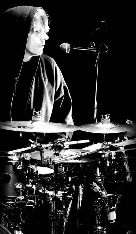 man sitting at a drumset